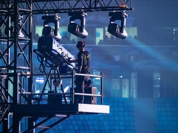A man controls the lighting equipment. Checking stage equipment.
