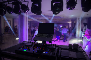 close up photo of a mixing desk in the dark at a wedding